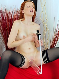 Astounding redhead inserts a buttocks plug into her..
